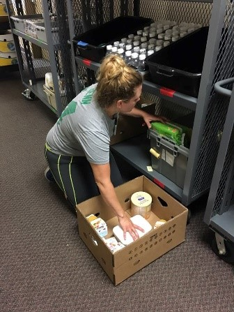 Rolling carts with shelves of groceries are transported via our box truck to communities at risk of food insecurity.
